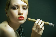 Elegant smoking woman Royalty Free Stock Photos