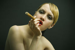 Elegant smoking woman Stock Images