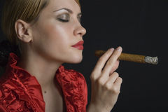 Elegant smoking woman Stock Photography
