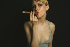 Elegant smoking woman Stock Images