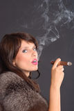 Elegant smoking woman Stock Photo