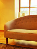 Elegant sofa in a sunlit room with big window Stock Photo