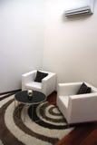 Elegant sofas. Modern elegant living room with white leather sofas Stock Photo