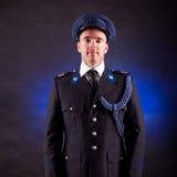 Elegant soldier wearing uniform Stock Images
