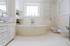 Elegant spacious bathroom. In designed luxury apartment stock photo