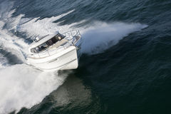 Elegant speed boat sailing through a deep ocean Royalty Free Stock Photo