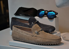 Elegant sport shoes. Modern sport shoes with sunglasses for man Royalty Free Stock Image