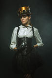 Elegant steampunk girl with the clock Stock Photos