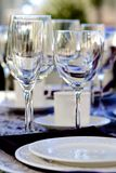 Elegant Stemware. Close-up of sparkling stemware and white china on a festive table Stock Photos