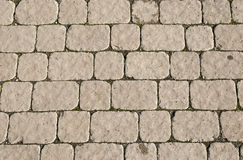 Elegant stone wall. From small square parts Stock Images
