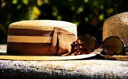 Elegant straw hat and designer glasses Stock Images