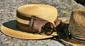 Elegant straw hat and designer glasses Stock Image