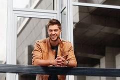 Elegant style handsome smiling man in the city Stock Photos