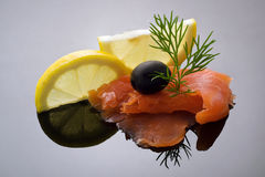Elegant styling salmon. With lemon slices, dill and black olive Stock Photography