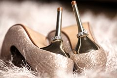 Elegant and stylish bridal shoes with wedding rings Royalty Free Stock Image