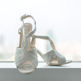 Elegant and stylish bridal  shoes in a window. - Shallow of focus Stock Images