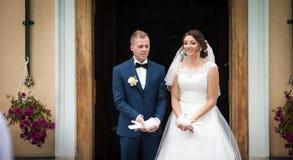 Elegant stylish brunette bride and groom holding pigeons on the Stock Image