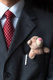 The elegant stylish businessman keeping cute Teddy bear in a his breast suit pocket. Formal negotiations concept. Stock Photo