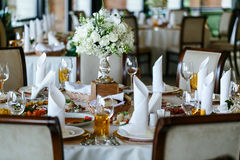 Elegant stylish decorated wedding reception tables with glasses royalty free stock photos