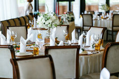 Elegant stylish decorated wedding reception tables with glasses Stock Images