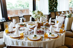 Elegant stylish decorated wedding reception tables with glasses Stock Photography