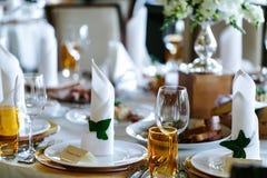 Elegant stylish decorated wedding reception tables with glasses Stock Photo