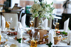 Elegant stylish decorated wedding reception tables with glasses Royalty Free Stock Image