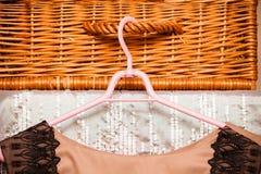 Elegant stylish dress on cloth hanger in wardrobe Royalty Free Stock Image
