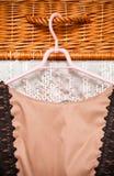 Elegant stylish dress on cloth hanger in wardrobe Royalty Free Stock Photo