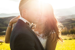 Elegant stylish happy brunette bride and gorgeous groom  on the Royalty Free Stock Photography