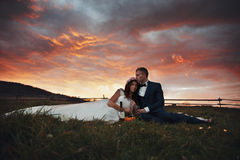 Elegant stylish happy brunette bride and gorgeous groom at the s. Unset on the background of fall mountains stock image