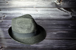 Elegant stylish hat. In front of a wooden background Stock Image