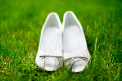 Elegant and stylish, modern wedding shoes against grass in garden Stock Photography
