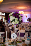 Elegant and stylish purple color wedding reception at luxury restaurant Royalty Free Stock Image
