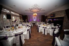 Elegant and stylish purple color wedding reception at luxury restaurant Stock Photography