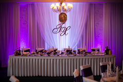 Elegant and stylish purple color wedding reception at luxury restaurant Royalty Free Stock Photos