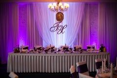 Elegant and stylish purple color wedding reception at luxury restaurant Royalty Free Stock Photos