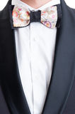 Elegant suit jacket and colored custom made bow tie Stock Images