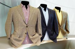 Elegant suits in deferent color. Various color of long sleeves & suits on shelf Royalty Free Stock Image