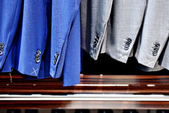 Elegant suits in a row inside suit store Stock Photo
