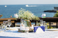 Elegant summer wedding table in front of the beach Stock Photos