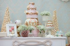 Elegant sweet table. With big cake and macaroon on dinner or event party royalty free stock photos