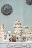 Elegant sweet table with big cake on wedding party Royalty Free Stock Photos