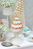 Elegant sweet table with cake on wedding party Stock Photography