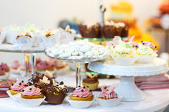 Elegant sweet table with cupcakes, cake pops and candy on dinner Stock Photo