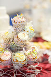 Elegant sweet table with cupcakes and other sweets for dinner or Royalty Free Stock Images