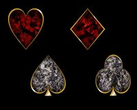 Playing cards symbols. Heart, diamond, spade (pike) and club (clover) with golden border and textures lava and volcanic ash. Neutral black background Stock Image