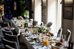 Elegant table arrangement and catering at wedding reception, sty Stock Images
