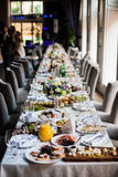 Elegant table arrangement and catering at wedding reception, sty Royalty Free Stock Image