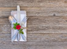 Elegant table place setting for Valentines day, anniversary, wedding and romantic dinner. Stock Photos